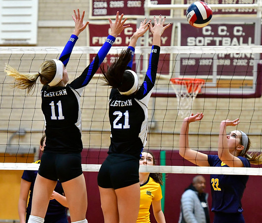 11/14/2018 Mike Orazzi | Staff Bristol Eastern's Ryley Plourde (11) and Aliana Rivoira (21) and Woodstock Academy's Natalie Low (22) during the Class L Semifinal State Girls Volleyball Tournament held at Windsor High School Wednesday night.