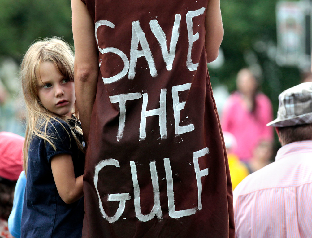 . Jolie Van Gilder, left, holds her mother\'s hand during a rally against BP PLC and the Gulf oil spill, in New Orleans, Sunday, May 30, 2010. (AP Photo/Jae C. Hong)