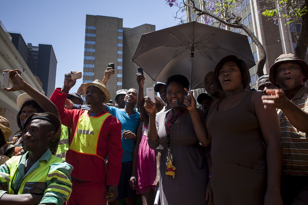 . Crowds gather outside the North Gauteng High Court during the sentencing of Oscar Pistorius on October 21, 2014 in Pretoria, South Africa.  (Photo by Charlie Shoemaker/Getty Images)