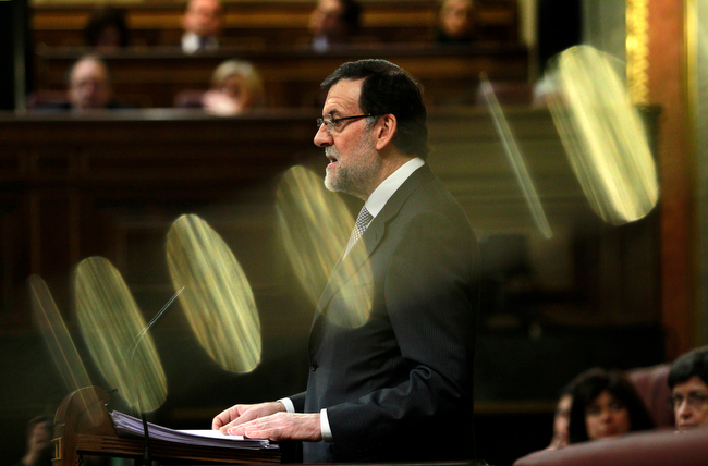 . Spain\'s Prime Minister Mariano Rajoy speaks during a state of the nation debate at the Spanish Parliament in Madrid, Spain, Wednesday, Feb. 20, 2013. (AP Photo/Andres Kudacki)