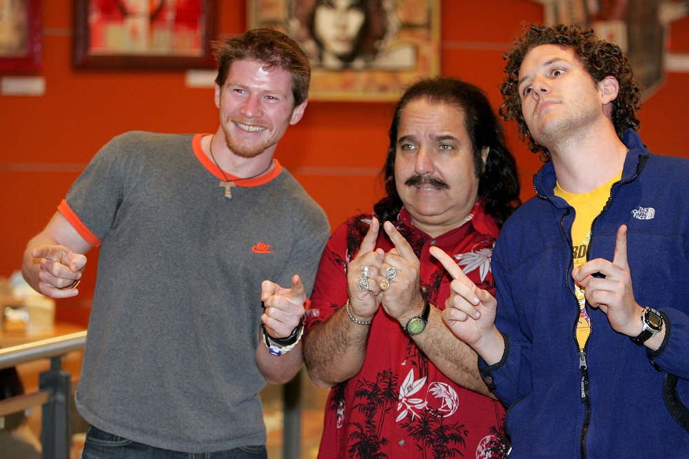 Description of . Adult Film Actor Ron Jeremy (C) poses with fans Shane Clark (L) and Chris Solarz of Manhattan during an appearance at Virgin Megastore Union Square to sign copies of the DVD Being Ron Jeremy March 15, 2005 in New York City.  (Photo by Paul Hawthorne/Getty Images)