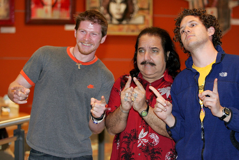 . Adult Film Actor Ron Jeremy (C) poses with fans Shane Clark (L) and Chris Solarz of Manhattan during an appearance at Virgin Megastore Union Square to sign copies of the DVD Being Ron Jeremy March 15, 2005 in New York City.  (Photo by Paul Hawthorne/Getty Images)