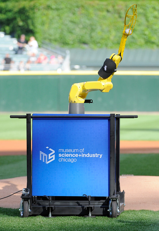 """. \"""" Baseball Bot\"""" throws out the ceremonial first pitch before a baseball game between the Chicago White Sox and the Detroit Tigers, Saturday, June 6, 2015 in Chicago.  (AP Photo/David Banks)"""