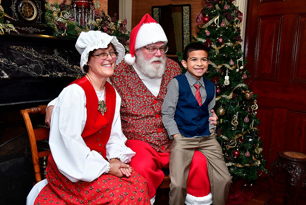 11/30/2019 Mike Orazzi | Staff Noah Bermudez,7, meets with Santa and Mrs Claus at The Barnes Museum in Southington on Saturday morning.