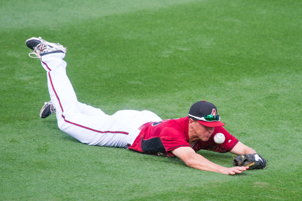 . Nick Ahmed #75 of the Arizona Diamondbacks attempts to make a play during a spring training game against the Colorado Rockies at Salt River Fields at Talking Stick on February 28, 2014 in Scottsdale, Arizona. (Photo by Rob Tringali/Getty Images)