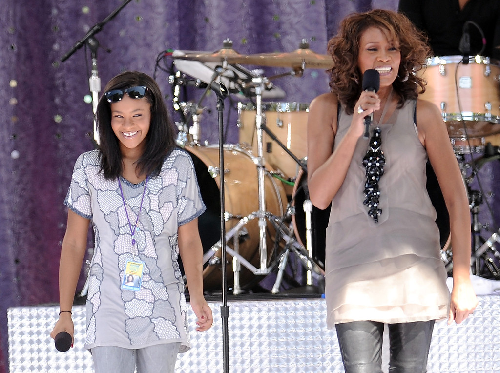 . Singer Whitney Houston, right, sings with her daughter Bobbi Kristina Brown during a performance on \'Good Morning America\' in Central Park on Tuesday, Sept. 1, 2009 in New York.  Houston was born August 9, 1963 in Newark, New Jersey and died February 11, 2012, in Beverly Hills, California at the age of 48. Bobbi Kristina died on July 26, 2015. (AP Photo/Evan Agostini)
