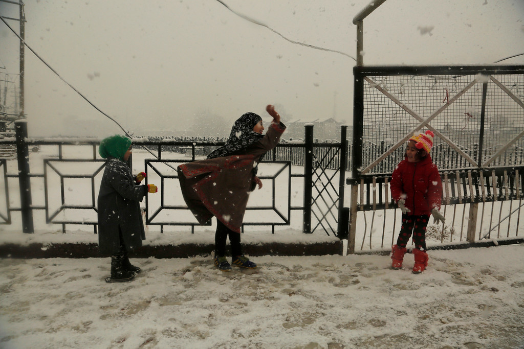 . Kashmiri children play in the snow in Srinagar, Indian controlled Kashmir, Friday, Jan. 6, 2017. Kashmir experienced snow for the fourth consecutive day resulting in the closure of the Srinagar-Jammu highway and suspension of air traffic, according to news reports. (AP Photo/Mukhtar Khan