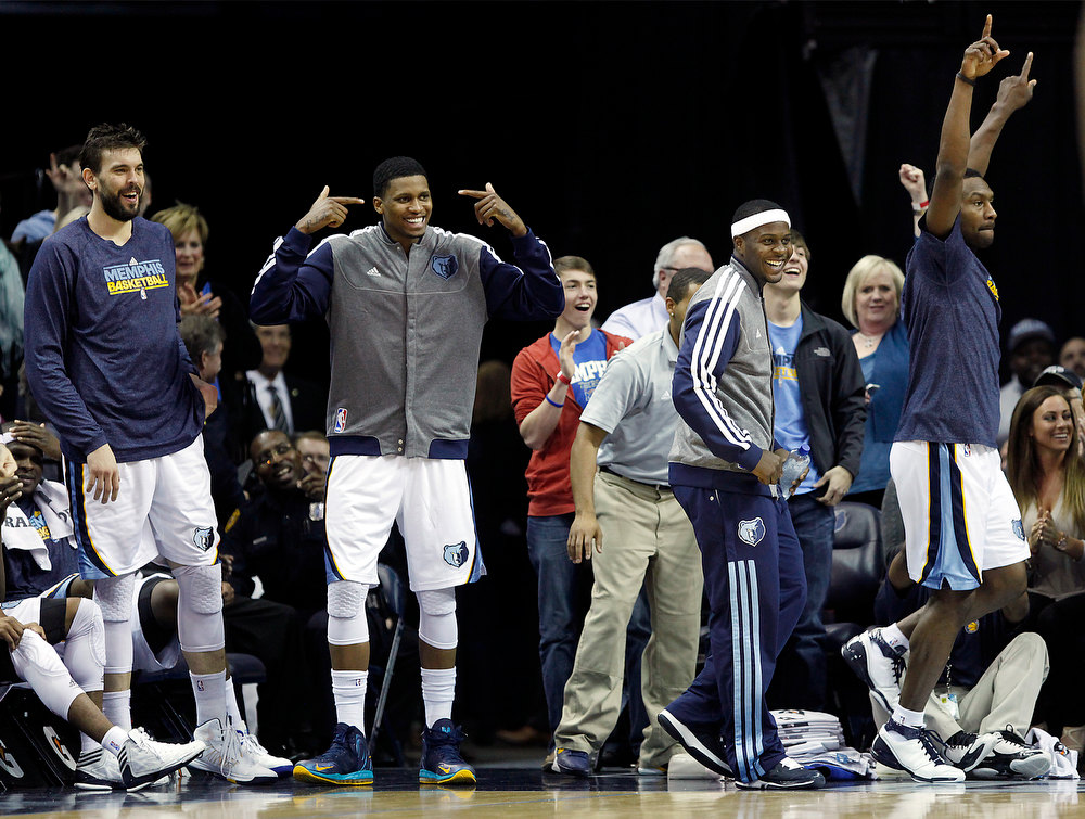 . From left, Memphis Grizzlies players Marc Gasol, Rudy Gay, Josh Selby and Tony Allen cheer on their teammates while playing the Denver Nuggets in the second half of an NBA basketball game on Saturday, Dec. 29, 2012, in Memphis, Tenn. The Grizzlies won 81-72. (AP Photo/Lance Murphey)