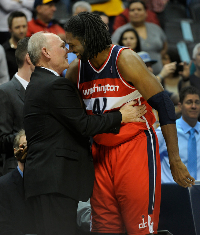 . DENVER, CO - JANUARY 18: Washington forward Nene greeted his former coach George Karl at the start of the contest Friday night. The Denver Nuggets hosted the Washington Wizard at the Pepsi Center Friday night, January 18, 2013. Karl Gehring/The Denver Post