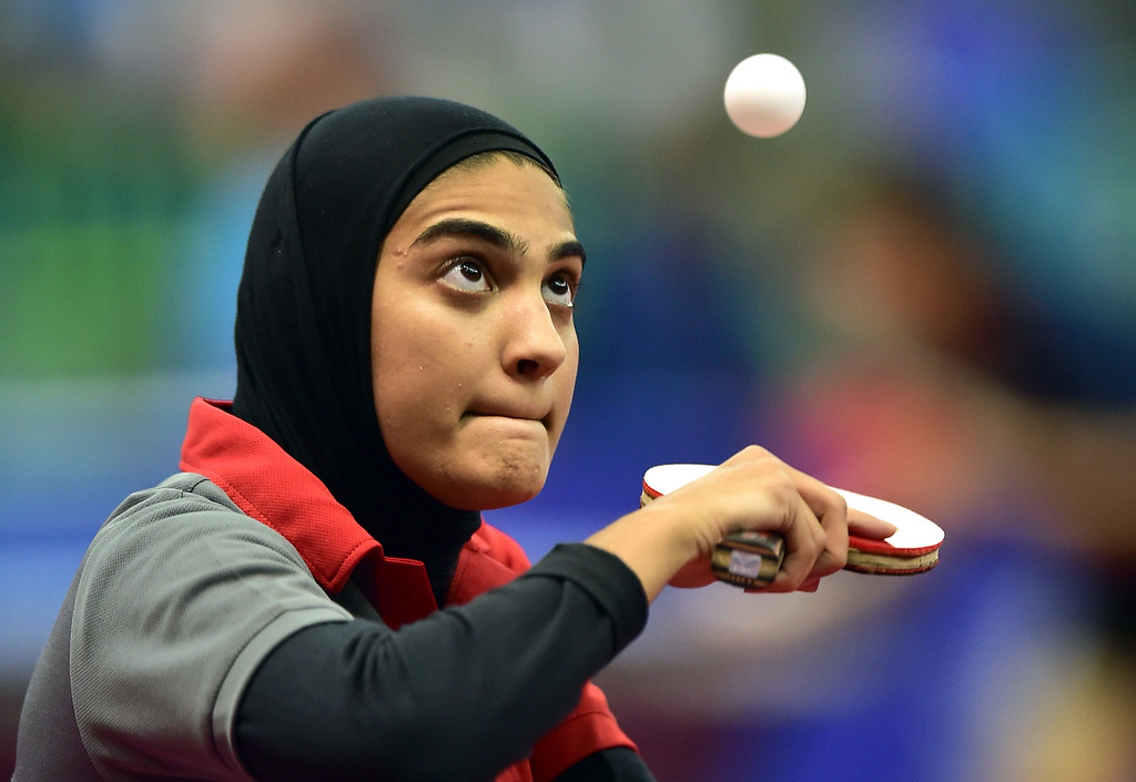 . Kuwait\'s Abdulraheem Maryam serves to Macao\'s Cheong Cheng in the women\'s team preliminary round table tennis event during the 2014 Asian Games at Suwon Gymnasium in Suwon, outside Incheon, on September 27, 2014. JUNG YEON-JE/AFP/Getty Images