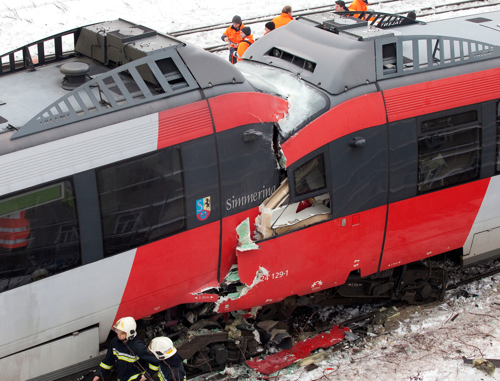 Description of . Firefighters secure the site where two trains of the line S45 crashed on January 21, 2013 in Vienna, Austria AFP PHOTO / DIETER NAGLDIETER NAGL/AFP/Getty Images