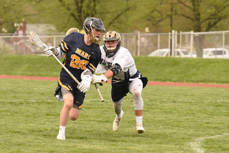 Jack Rice(26) of Mars pushes past Matt Goodlin of Knoch in Wednesday's home win. Seb Foltz/Butler Eagle