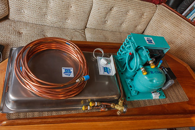 The refrigeration system unpacked on my dinette table.