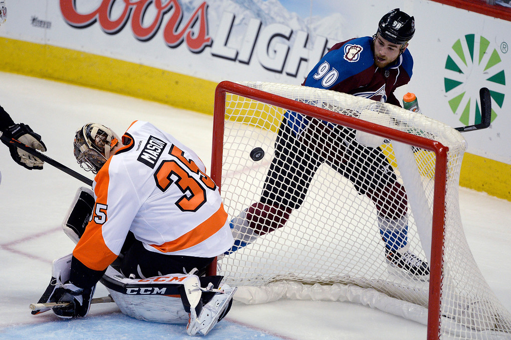 . Colorado Avalanche center Ryan O\'Reilly (90) skates behind Philadelphia Flyers goalie Steve Mason (35) as he watches his shot goal in the goal for a score during the second period January 2, 2014 at Pepsi Center. (Photo by John Leyba/The Denver Post)
