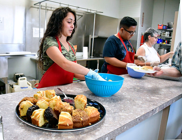 8//8/2019 Mike Orazzi | Staff Jazmin Vazquez, Nestor Martinez and Janet Chamberland serve meals at the Meals for Neighbors program at Zion Evangelical Lutheran Church in Bristol.