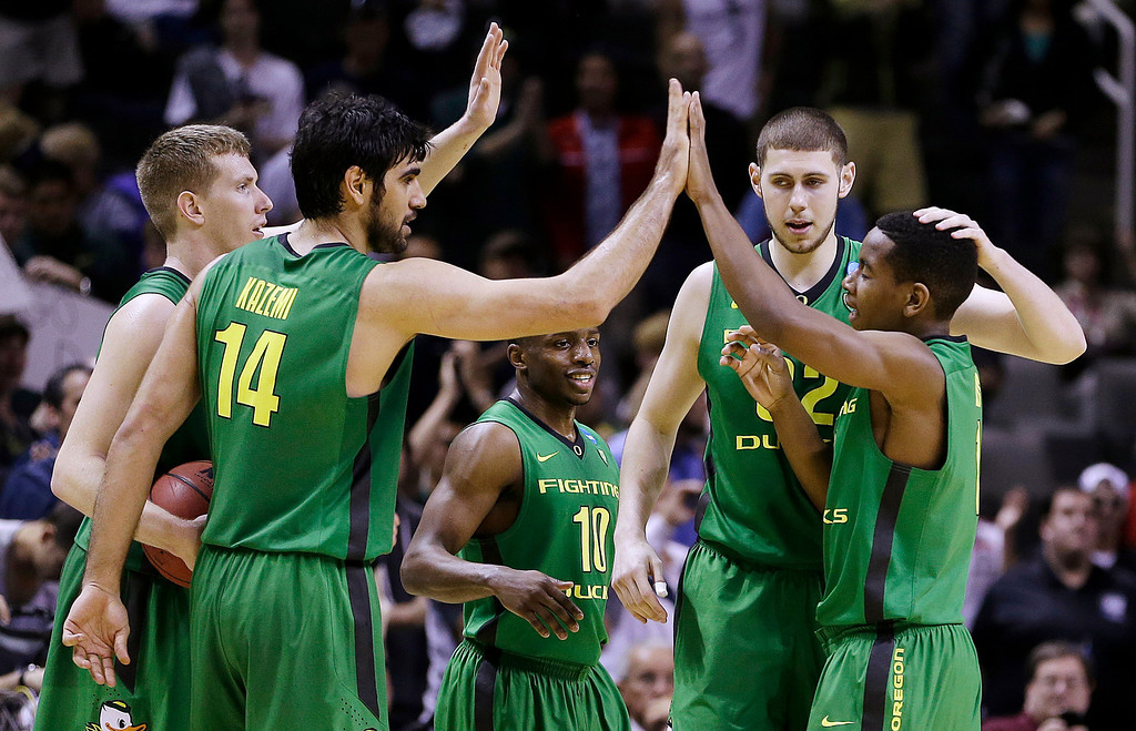 . Oregon players celebrate on the court during the second half of a second-round game in the NCAA college basketball tournament against Oklahoma State in San Jose, Calif., Thursday, March 21, 2013. Oregon won 68-55. (AP Photo/Ben Margot)