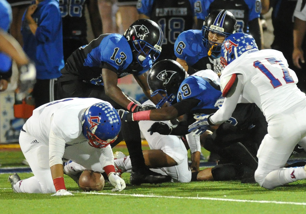 . Los Altos\' Elijah Herrera (#23) recovers an onside kick from Diamond Ranch in their Hacienda League opener football game at Diamond Ranch High School in Pomona on Friday October 4, 2013. (Whittier Daily News/Staff Photo by Keith Durflinger)