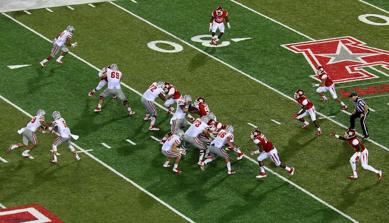 UNLV's Decker hands the ball off to a running back.