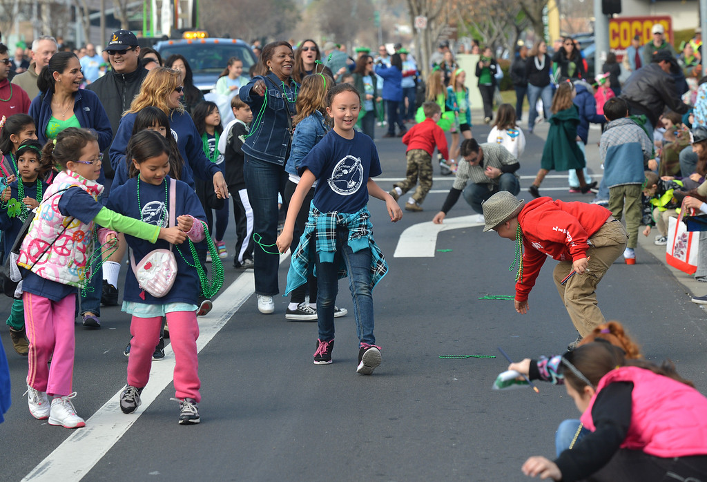 . Students from Kolb Elementary School in Dublin throw green necklaces into the crowd during the Saint Patrick\'s Day Parade in Dublin, Calif., on Saturday, March 16, 2013. (Dan Rosenstrauch/Staff)