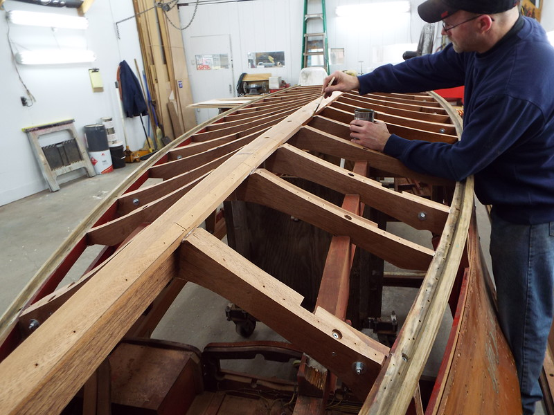 Sealing the new frames with epoxy before installing the new bottom skin.