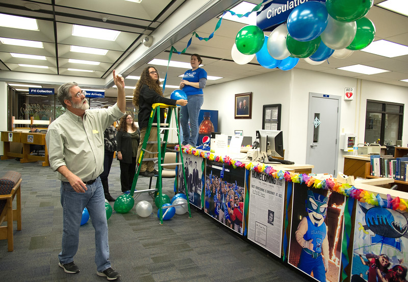 Mary and Jeff bell library 's staff decorate their circulation desk for Homecoming 2015.