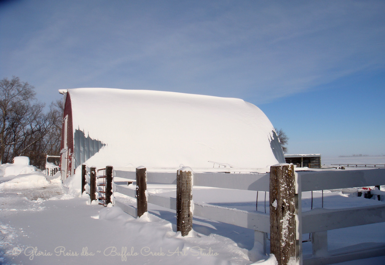 snow bank covering the barn