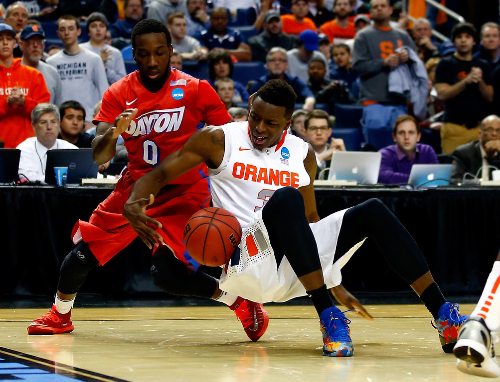 . BUFFALO, NY - MARCH 22: Jerami Grant #3 of the Syracuse Orange and Khari Price #0 of the Dayton Flyers battle for a loose ball during the third round of the 2014 NCAA Men\'s Basketball Tournament at the First Niagara Center on March 22, 2014 in Buffalo, New York.  (Photo by Jared Wickerham/Getty Images)