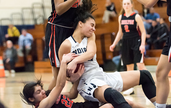 02/26/19 Wesley Bunnell | Staff Newington girls basketball vs Shelton in a CIAC playoff game played at home on Tuesday night. Olivia St. Remy (20) fights for the ball as she falls on top of Shelton's #22.