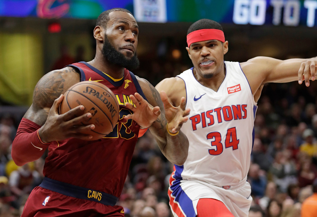 . Cleveland Cavaliers\' LeBron James, left, drives against Detroit Pistons\' Tobias Harris in the first half of an NBA basketball game, Sunday, Jan. 28, 2018, in Cleveland. (AP Photo/Tony Dejak)
