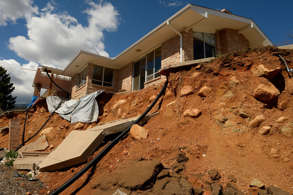 . This home belonging to Rick Sisco on Constellation drive has become a victim to the ancient landslides that are being found along the foothills on April 11, 2016 in Colorado Springs, Colorado.  Over 200 homeowners in the city  have applied for federal bailouts because their homes are being eaten up by collapsing expansive soil that is part of an ancient and massive landslide area.   It is a problem that city officials have known about since the mid-1990\'s when city planners approved developments on what geologists have called some of the most unstable geology on the front range.  (Photo by Helen H. Richardson/The Denver Post)