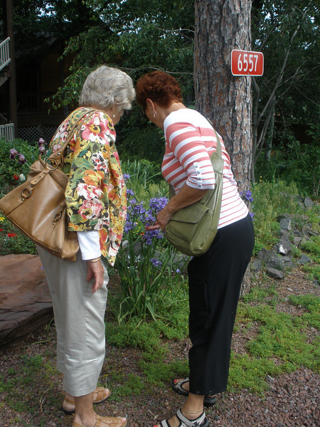 Cathy and Vadis checking garden plants at Orthodox Monastory on shore of Lake Superior
