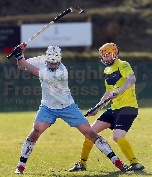 Calum Shepherd looks on as John Gillies drives the ball upfield.