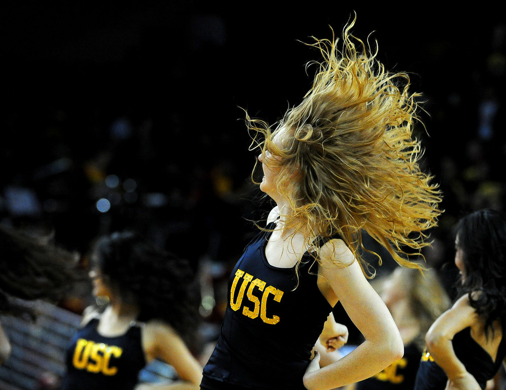 . Southern California cheerleaders perform in the second half of a PAC-12 NCAA basketball game between UCLA and Southern California at Galen Center in Los Angeles, Calif., on Saturday, Feb. 8, 2014. UCLA won 83-73. (Keith Birmingham Pasadena Star-News)