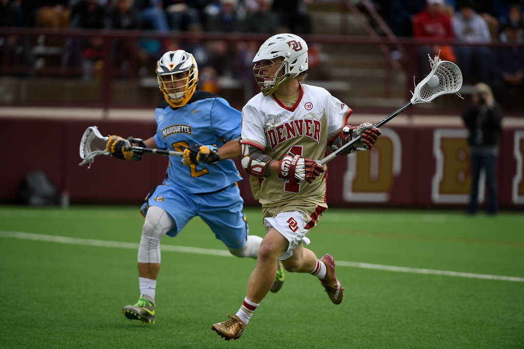 . Denver Pioneers Austin French #4 looks for an opening against Marquette Golden Eagles Noah Joseph #2 in the third quarter during the Big East Championship game at Peter Barton Stadium May 07, 2016. (Photo by Andy Cross/The Denver Post)