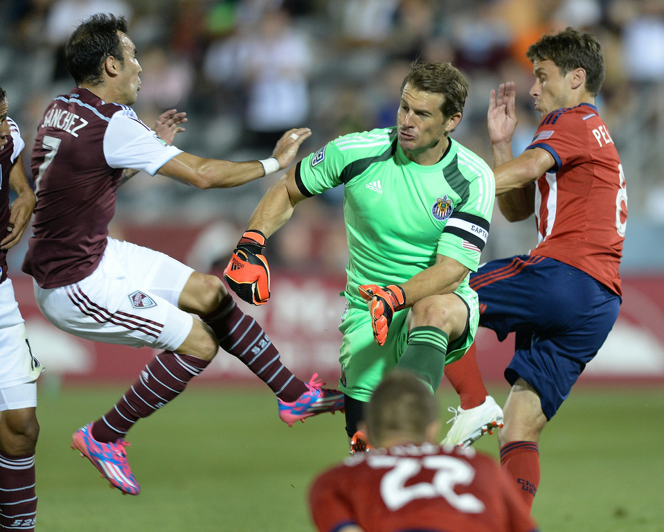 . Colorado forward Vicente Sanchez collided with Chivas goaltender Dan Kennedy in the second half. The Colorado Rapids defeated Chivas USA 3-0 at Dick\'s Sporting Goods Park Friday night, July 25, 2014. Photo by Karl Gehring/The Denver Post
