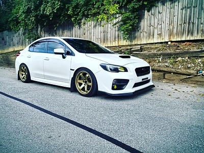 Ryan's 2017 Subaru WRX on 18x9.5 Gold Grids