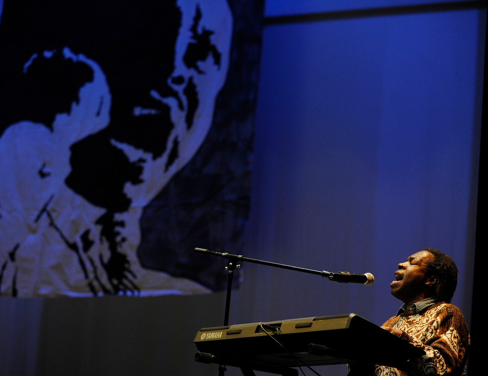 . An image of the late Martin Luther King Jr. flashes on the screen as a member of the Pittsburg Gospel Group performs at an event held at the Creative Arts Building on Martin Luther King Jr. Day in Pittsburg, Calif., on Monday, Jan. 21, 2013.  (Susan Tripp Pollard/Staff)