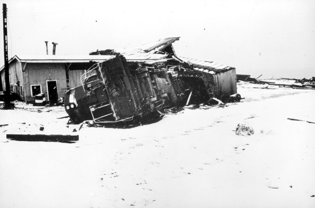 . Alaska Earthquake March 27, 1964. Wave action moved this 120 ton locomotive 130 feet inland and 5 feet vertically. Photo by R.W. Lemke,  U.S. Geological Survey