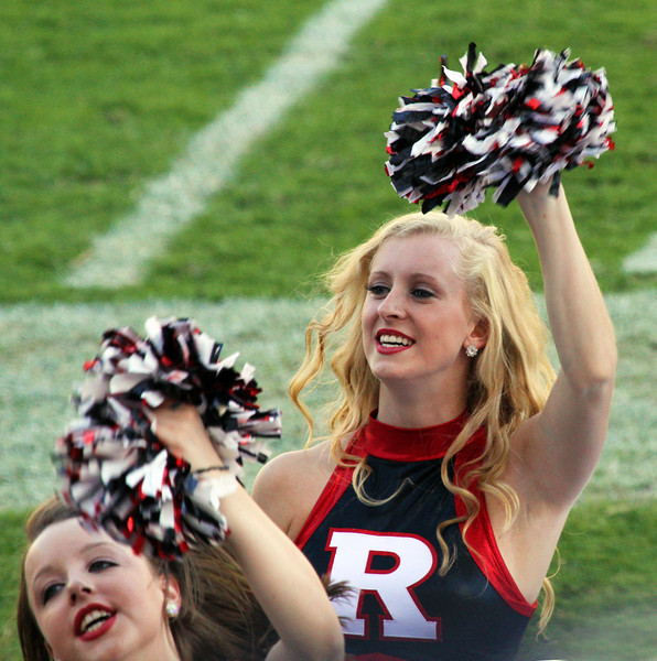 Two Rutgers cheerleaders are pretty cheery as fortune swings Rutgers' way
