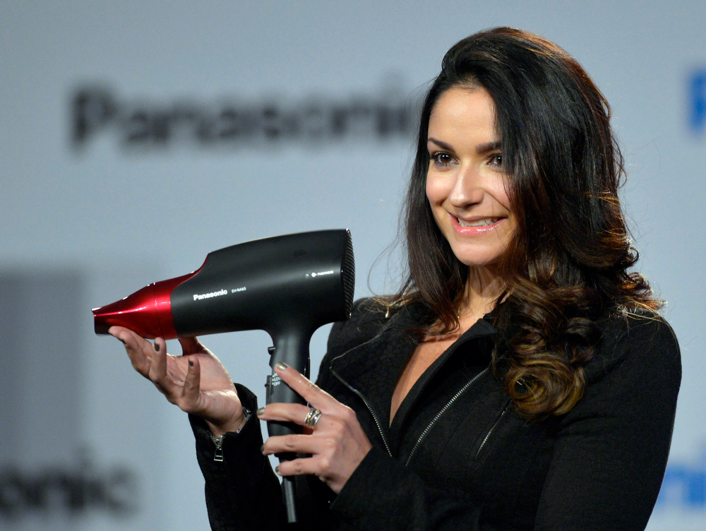 Description of . Panasonic shows the new EH-NA65 hair dryer during the Panasonic news conference at the 2014 International Consumer Electronics Show, Monday, Jan. 6, 2014, in Las Vegas. (AP Photo/Jack Dempsey)