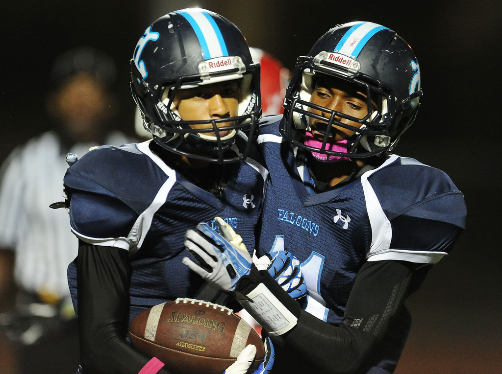 . Duarte\'s Victor Nureldeen, left, reacts with teammate Devyn Washington (11) after catching a pass for a touchdown against Gladstone in the first half of a prep football game at Duarte High School in Duarte, Calif., Thursday, Oct. 10, 2013.    (Keith Birmingham Pasadena Star-News)