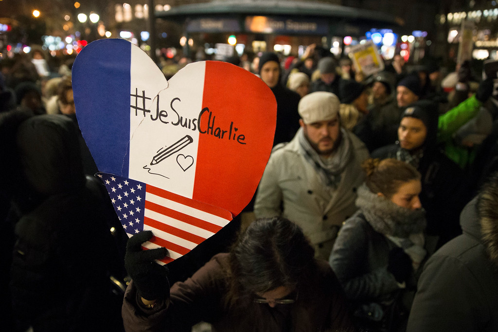 . Mourners attend a rally in support of Charlie Hebdo, a French satirical weekly newspaper that fell victim to an terrorist attack, Wednesday, Jan. 7, 2015, at Union Square in New York. French officials say 12 people were killed when masked gunmen stormed the Paris offices of the periodical that had caricatured the Prophet Muhammad. (AP Photo/John Minchillo)