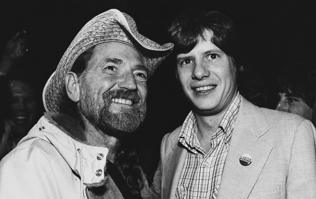 . Country music singer Willie Nelson (left) poses with President Carter\'s son Chip at a fund raiser in Atlanta at night on Tuesday, April 15, 1980. The Western Party held at the old Fox Theater drew about 500 Carter supporters in cowboy regalia at $250 per couple. Two concerts played to a full house at $12.50 per ticket. The theater holds 4,000. (AP Photo/Nancy Magiafico)