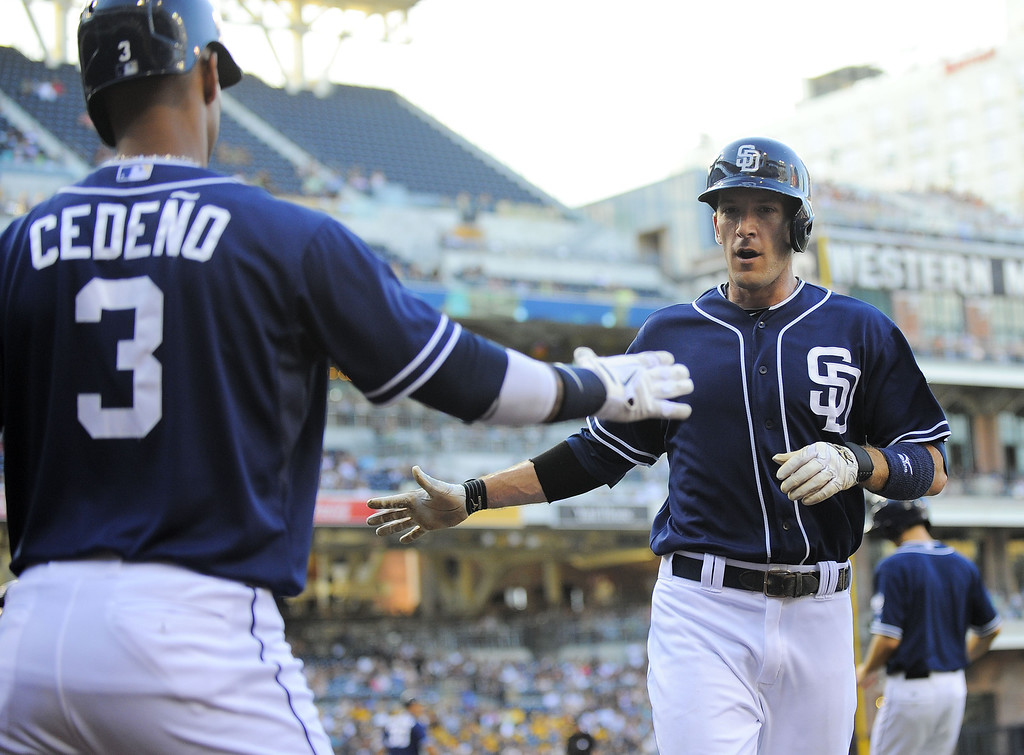 . SAN DIEGO, CA - SEPTEMBER 7:  Chris Denorfia #13 of the San Diego Padres, right, is congratulated by Ronny Cedeno #3 after scoring during the first inning of a baseball game against the Colorado Rockies at Petco Park on September 7, 2013 in San Diego, California.  (Photo by Denis Poroy/Getty Images)