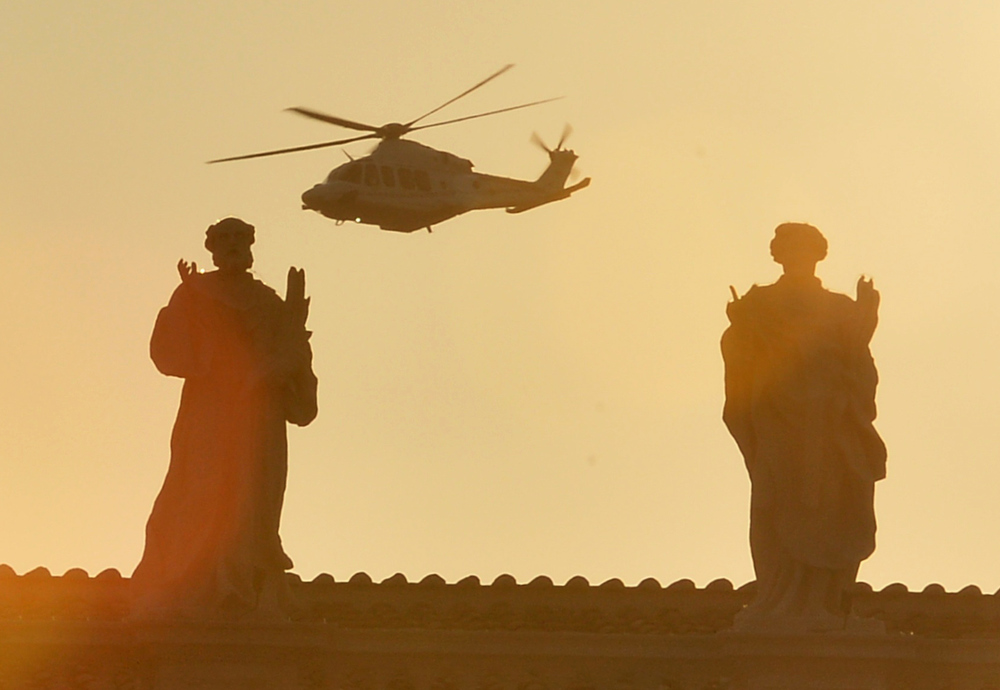 . The helicopter with Pope Benedict XVI aboard flies past St Peter�s square at the Vatican on February 28, 2013 in Rome.  Pope Benedict XVI boarded  a helicopter to fly to the papal summer residence of Castel Gandolfo outside Rome, where he will stay until his powers formally expire at 1900 GMT.  ALBERTO PIZZOLI/AFP/Getty Images