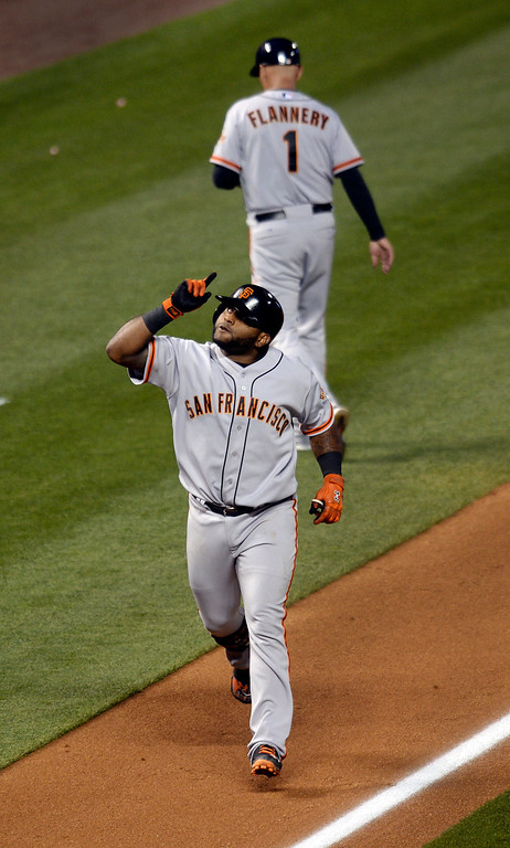 . Giants slugger Pablo Sandoval rounded the bases after his sixth inning home run off Colorado starter Jhoulys Chacin. The Colorado Rockies hosted the San Francisco Giants Wednesday night, May 21, 2014.  (Photo by Karl Gehring/The Denver Post)