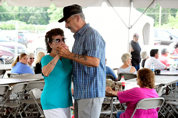 7/28/2018 Mike Orazzi | Staff Roseann Sliwa and Mike Prue dance to music from the Sam Vincent Quintet during the 14th annual Italian Festival held of Lower Center Street in Southington Saturday.