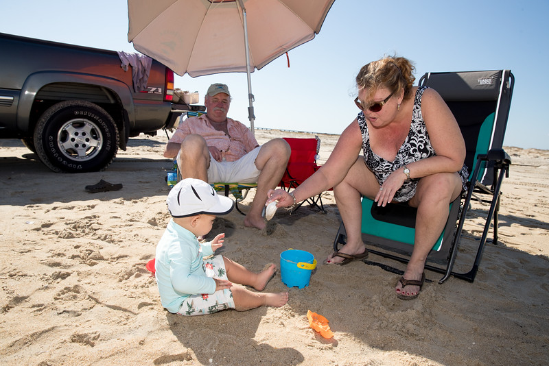 Kathleen and Paul Playing with Brady on the Beach.jpg