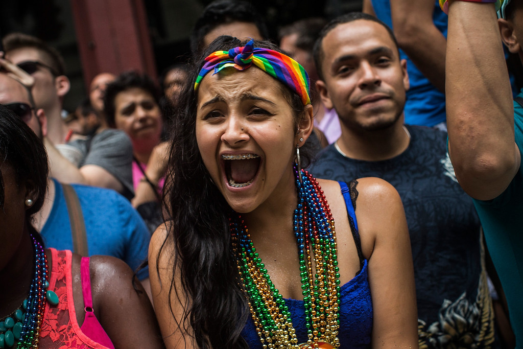 . Revelers watch the New York Gay Pride Parade on June 30, 2013 in New York City.  This year\'s parade was a particularly festive occasion, due to the recent Supreme Court Ruling that it was unconstitutional to ban gay marriage.  (Photo by Andrew Burton/Getty Images)