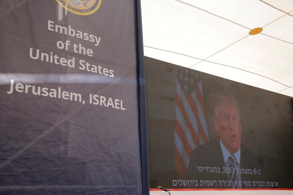 . U.S. President Donald Trump is seen on screen as he delivers his speech during the opening ceremony of the new U.S. embassy in Jerusalem, Monday, May 14, 2018. Amid deadly clashes along the Israeli-Palestinian border, President Donald Trump\'s top aides and supporters on Monday celebrated the opening of the new U.S. Embassy in Jerusalem as a campaign promised fulfilled. (AP Photo/Sebastian Scheiner)